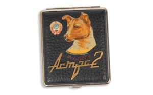 One of the most popular canvases for Laika's image was the cigarette case. These ranged from inexpensive boxes to more finessed plated metal and leather cases. Many featured Laika alongside Communist emblems and portraits of Lenin.