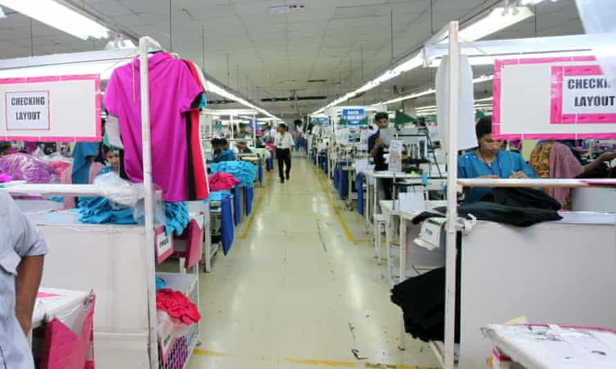 A supervisor stands inside the premises of a Jordan-based garment manufacturer for a top U.S. retailer in Irbid, Jordan.