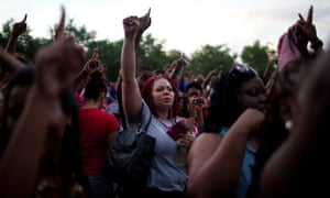 Activists raise their fists in unity during a rally in Chicago's South Side for Trayvon Martin in addition to ending gun violence in their own city.