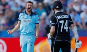 England's Mark Wood celebrates the dismissal of New Zealand's Mitchell Santner by LBW.