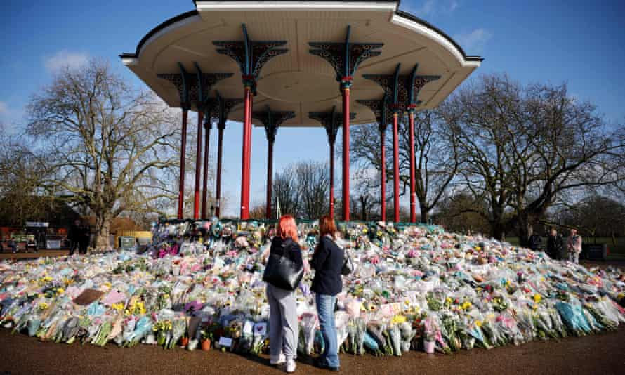 Clapham Common's bandstand with flowers and messages to honour Sarah Everard.