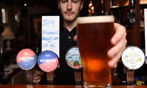 A barman in Dublin proffers a pint of Big Mistake Brexit IPA.