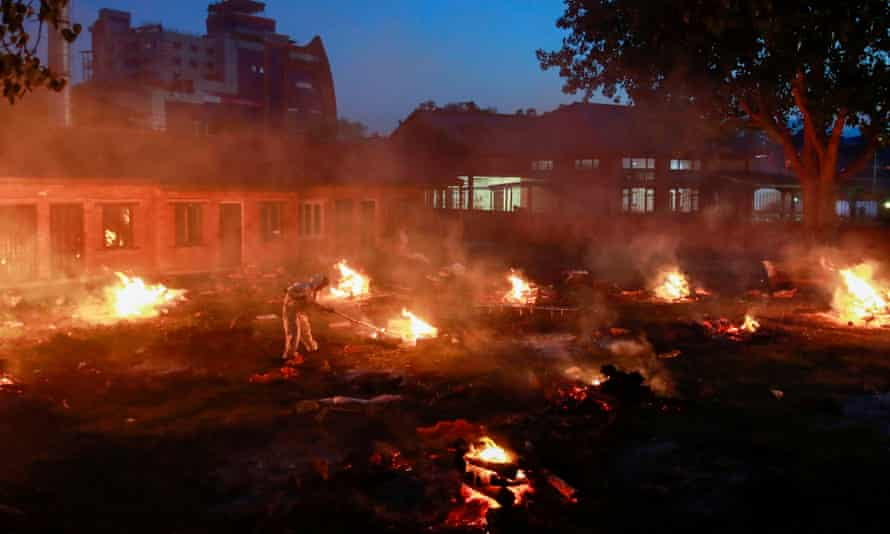 A mass cremation of Covid victims is held on the grounds of Pashupatinath temple in Kathmandu.