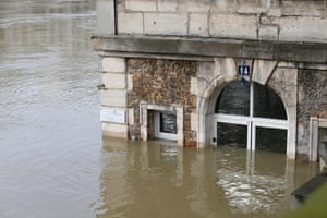 The Les Nautes cafe, partly immersed in floodwater