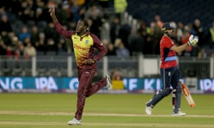 West Indies' Carlos Brathwaite celebrates after taking the wicket of England's Liam Plunkett to win the T20 match.