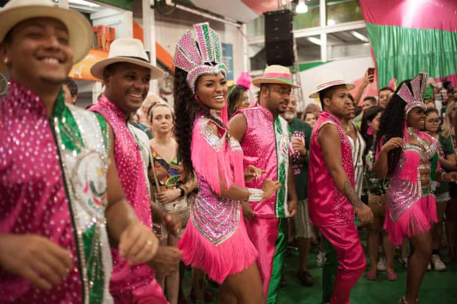Samba dancers perform at the Mangueira samba school rehearsal