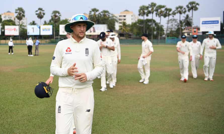 England captain Joe Root leads his team from the field after the tour match against the Sri Lanka Board President's XI was abandoned in Colombo.