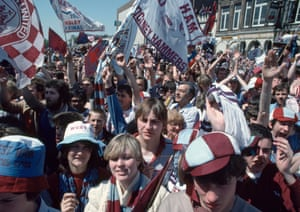 West Ham United fans celebrate in the streets of East London after their team won the 1980 FA Cup Final