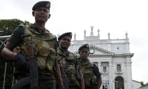 Soldiers stand guard at St Lucia's cathedral in Colombo, Sri Lanka