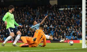 Manchester City's Gabriel Jesus can't stretch his leg long enough to poke the ball into the net.
