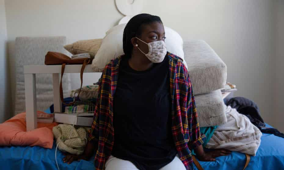 Melissa Wilson sits inside her Fort Worth apartment, in need of repair after flooding caused by a burst pipe.