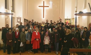 Worshippers from the Shia Ithna'ashari Community of Middlesex attending midnight mass at St Alban's