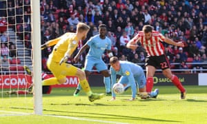 Will Grigg jabs home Sunderland's third.