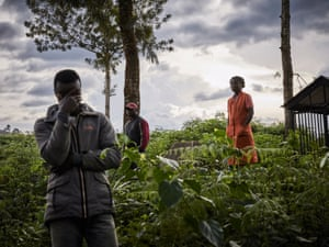 Mourners at the funeral of two Ebola victims in Butembo, DRC