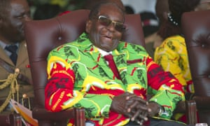 Robert Mugabe smiles during a youth rally