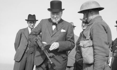 Winston Churchill with a cigar and a 'tommy gun' inspects invasion defences near Hartlepool in 1940.