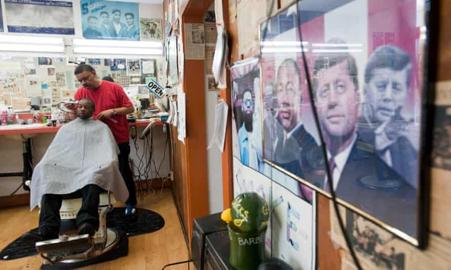Barber Earl Clark with a customer at his shop in the Alberta Arts District in Portland Oregon.