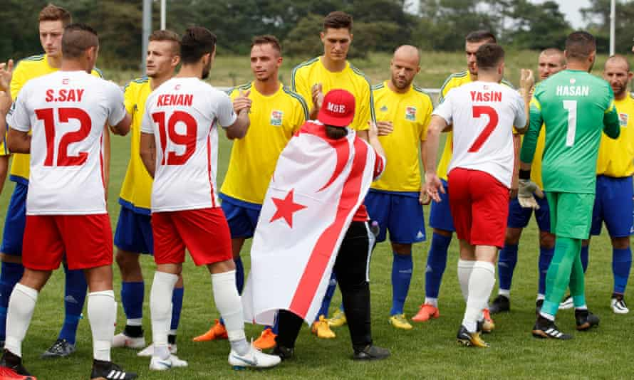 Northern Cyprus and Karpatalya shake hands before their match at Enfield.
