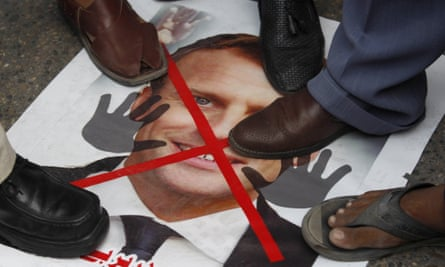 A poster of Macron is trampled at a protest in Karachi, Pakistan on 6 November.