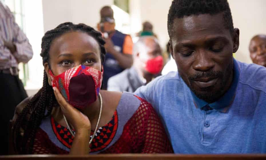 Bobi Wine in court in Iganga with his wife, Barbara Itungo.