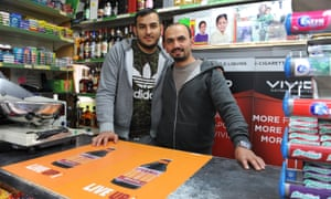 Father and son Kenan and Olgan Yildrim behind the counter of the Hackney Food Center.