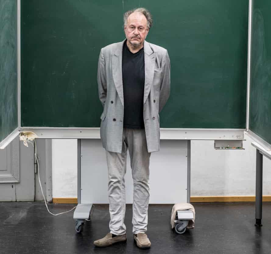 Jürgen Wertheimer, who set up Project Cassandra, standing in front of a green chalkboard
