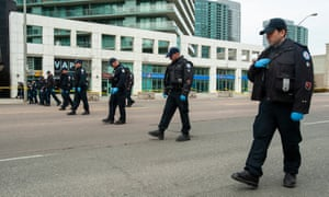 Police search for evidence along Yonge Street in northern Toronto, Canada Tuesday.