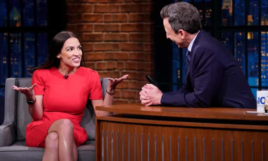 Alexandria Ocasio-Cortez talks to late-night host Seth Meyers.