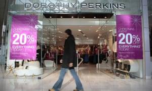 a shopper passes Dorothy Perkins