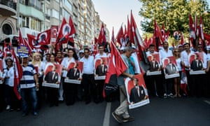 Demonstrators hold a potrait picture of Mustafa Kemal Ataturk, founder of modern Turkey, on Sunday.