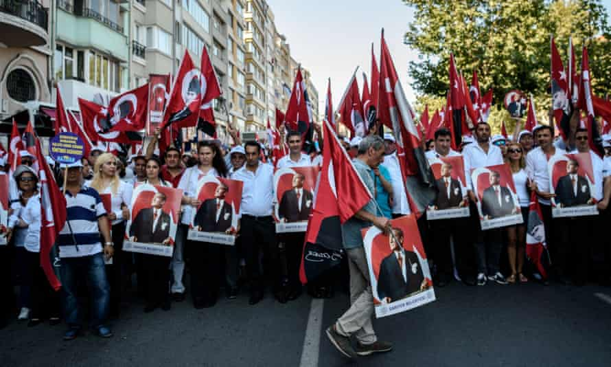 Demonstrators hold a potrait picture of Mustafa Kemal Ataturk, founder of modern Turkey, on Sunday.