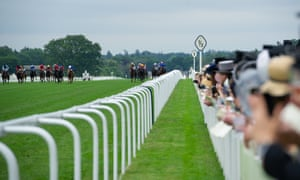 Racegoers watch the action at Royal Ascot.
