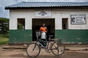'I'm very proud of my bicyelce,' says Anick, pictured in front of the collection centre in Zimba. 'The whole community - and the other Kaziwa women - they admire these bikes. We want everyone to have the chance to own one, to be able to change their way of living for the better.'