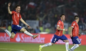 Angelo Henriquez, Mauricio Isla and Gary Medel celebrate.