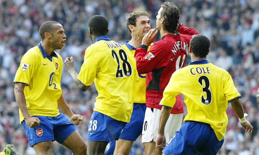 Arsenal's Martin Keown (third right) goes beserk at Manchester United's Ruud Van Nistelrooy (second right) after his penalty miss at Old Trafford in 2003.