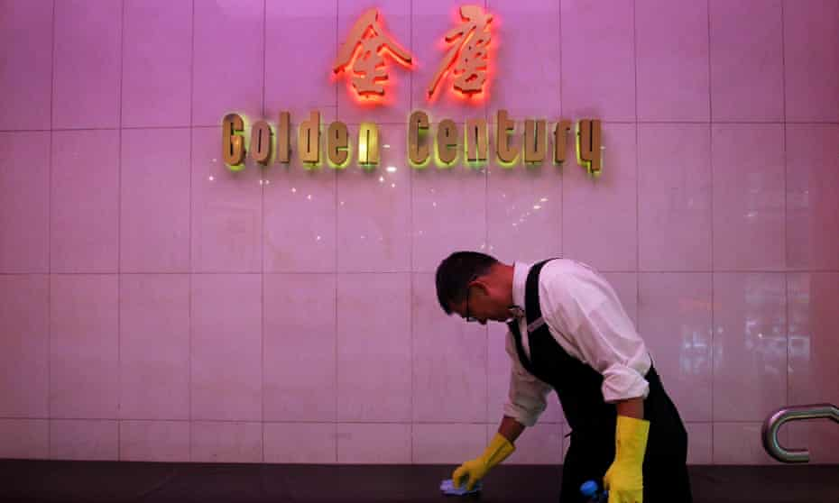 Restaurant waiter Ben cleans surfaces and hand railings at the award winning Golden Century Seafood Restaurant in Chinatown on March 05, 2020 in Sydney, Australia.