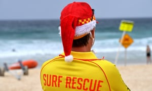 A surf lifesaver is seen on a windy and rainy Christmas Day on Bondi Beach in Sydney. NSW Covid restrictions have eased slightly over the Christmas period to allow gatherings but experts fear it could become a superspreading event.