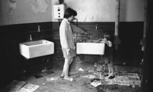 A family uses a public convenience in the East End of London, 1960s.