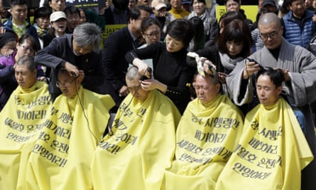 Ferry disaster families shave their heads in protest