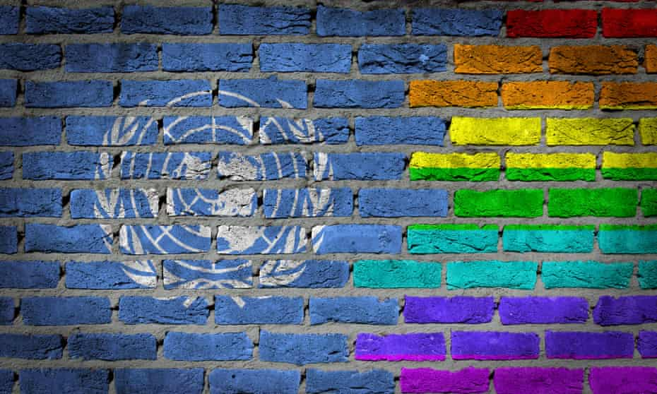 Wall painted with UN and rainbow flags