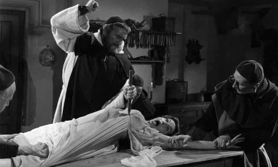 Monks hammer a stake into the heart of the vampire in Dracula: Prince of Darkness (1966)