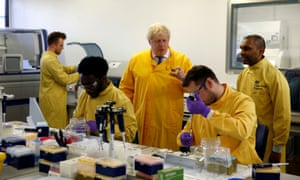 Boris Johnson visits a laboratory at the Public Health England National Infection Service in London in early March.