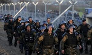 Macedonian riot police patrol at the border with Greece at Gevgelija