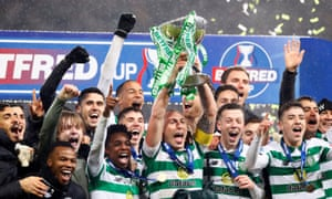 Scott Brown celebrates with his Celtic teammates after winning the Scottish League Cup Final.