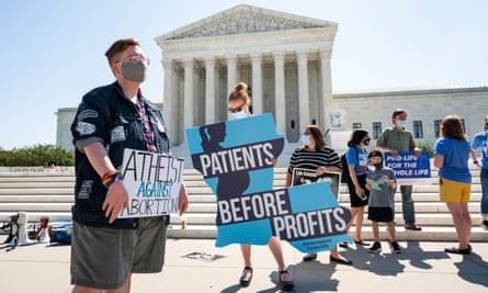 Competing protesters, outside the supreme court in June.