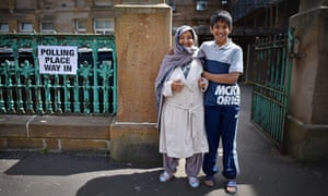 Members of the public at Pollokshields primary school polling station in Glasgow, Scotland.