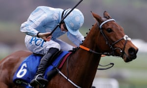 Rachael Blackmore urges Honeysuckle on to win the Mares Hurdle race at Cheltenham.