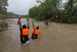 Gonzaga Town, Philippines. A resident is pulled along a rope as rescuers wait on the other side of a swollen river in Cagayan province. At least nine people were killed and 11 others reported missing after landslides and flash flooding set off by Tropical Storm Kompasu, which barrelled through the northern tip of the country overnight
