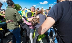 Police with demonstrators at fracking site Preston New Road