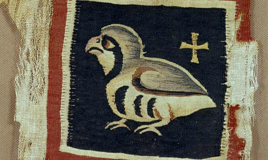 An Egyptian tapestry panel depicting a bird and a cross, 5th-7th century AD.